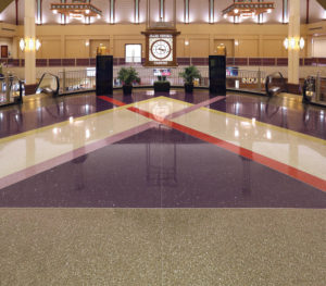 upper level of Grand Victoria Casino terrazzo with clock and escalators
